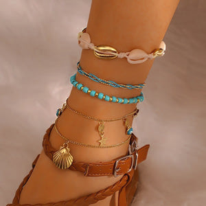 Turquoise and gold shell anklet set on a woman's ankle