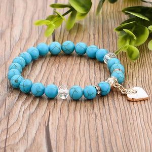 Turquoise natural stone bracelet with a gold heart charm