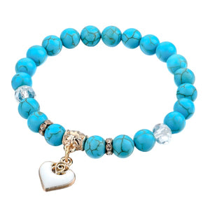 Beaded turquoise stone bracelet with a gold heart charm
