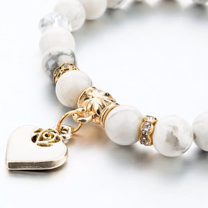 Gold heart charm on a white marble bead bracelet
