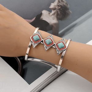 Woman wearing a wide silver and turquoise Aztec cuff bracelet