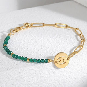 Zodiac bracelet with gold link chain, green crystal beads, and a round zodiac sign plate