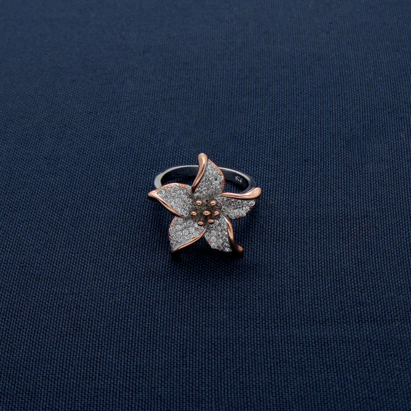 A Silver Flora Silver Ring With Golden Outline