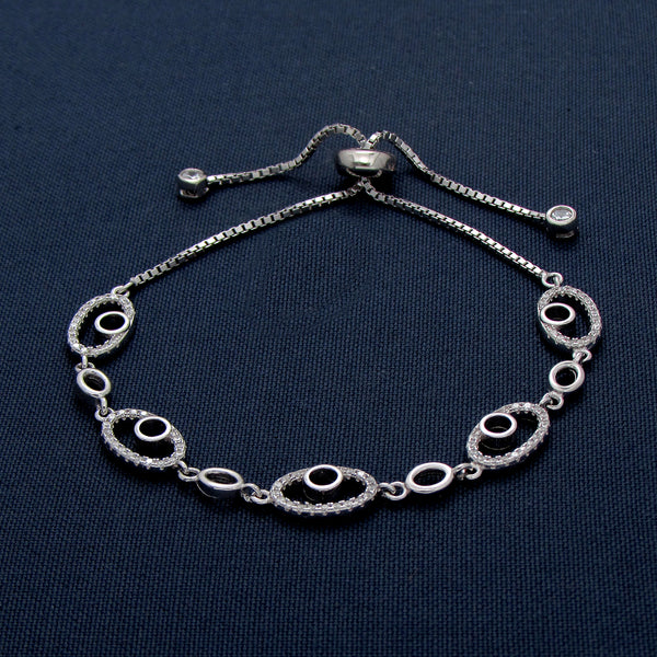 Sterling Silver Bracelet with Oval-shaped Decorations