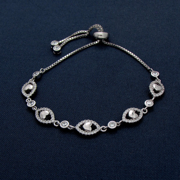 Silver Bracelet with Seed-Shaped and Tiny Heart Designs