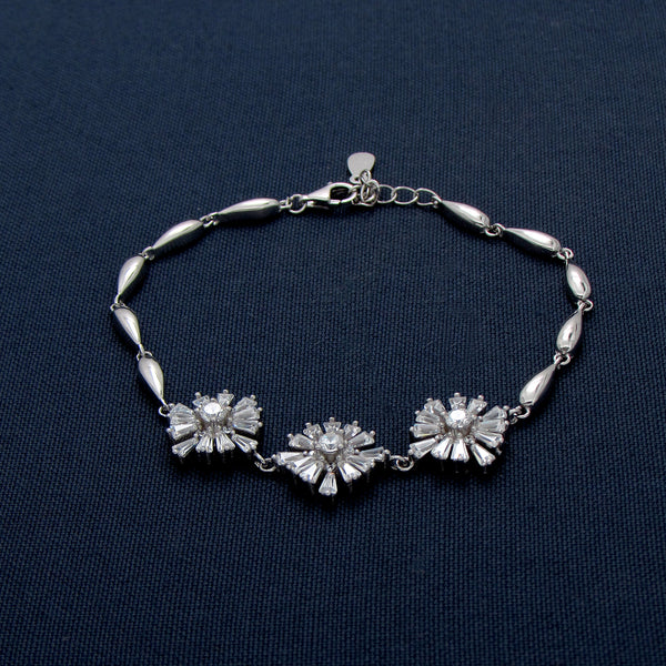 Dangling Silver Bracelet with Flower-Shaped Designs
