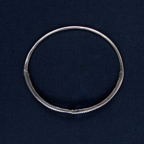 Silver Bracelet with a Gem-Covered Center