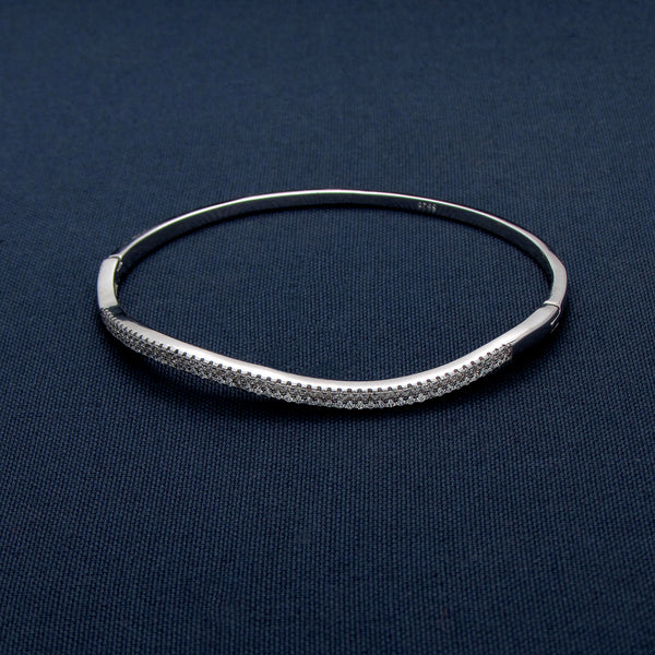 Silver Bangle with a Curve Design Covered in Sparkling Stones