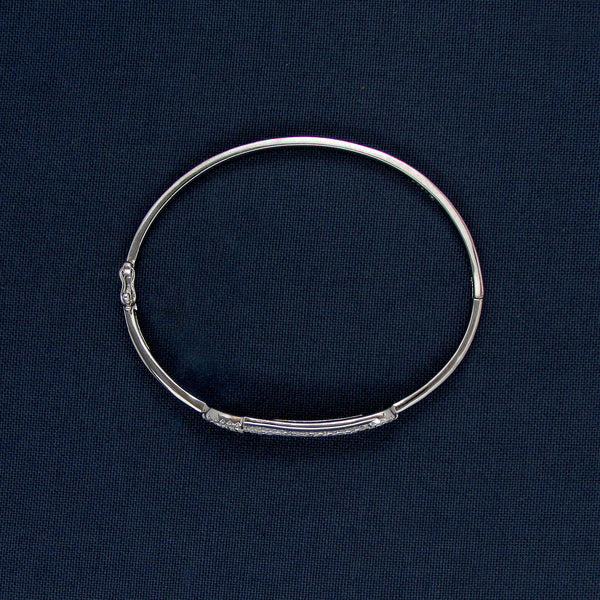 Silver Bracelet with a Unique Stone-Covered Bar Center