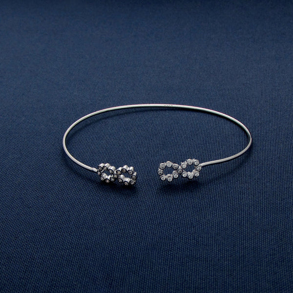 Half-Closed Silver Bracelet with Infinity Designs Covered in Gems