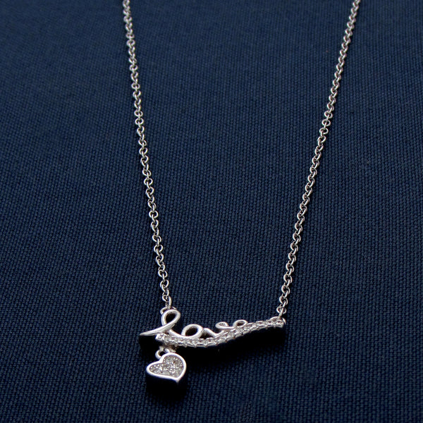Silver Love Pendant with a Heart-Shaped Design