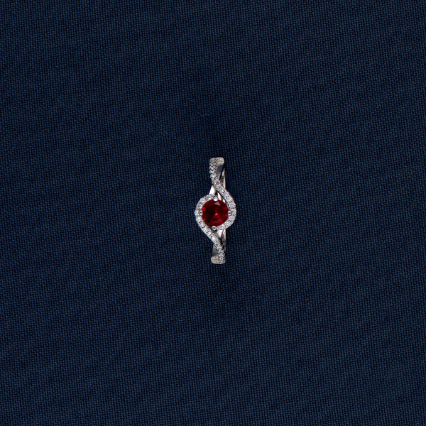 Red-Colored Gem Set in a Sterling Silver Ring