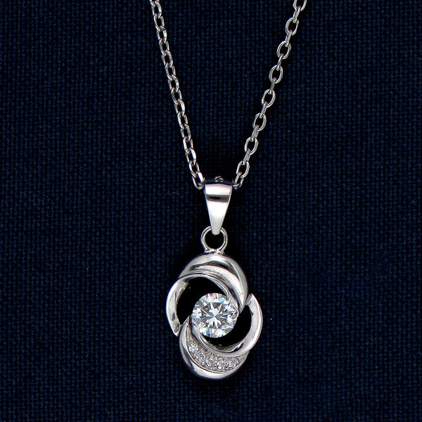 Swirling Silver Pendant with a Sparking Stone Inlay at the Center