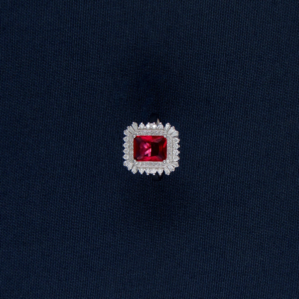 Silver Ring with a Square-Shaped Red Gem Centerpiece