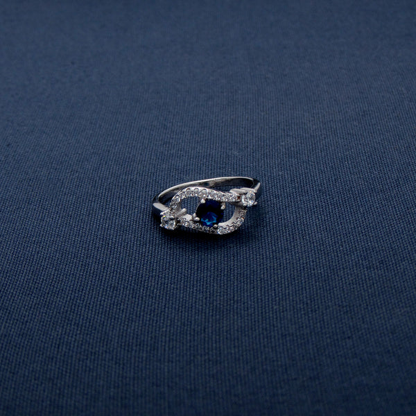 Silver Ring with Wave-Shaped Design and Blue Gem Inlay