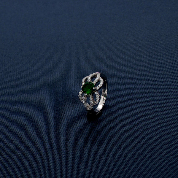 Sterling Silver Ring with a Green Gem at the Center
