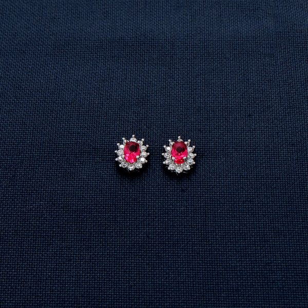 Oval-Shaped Silver Earrings with Red Gem