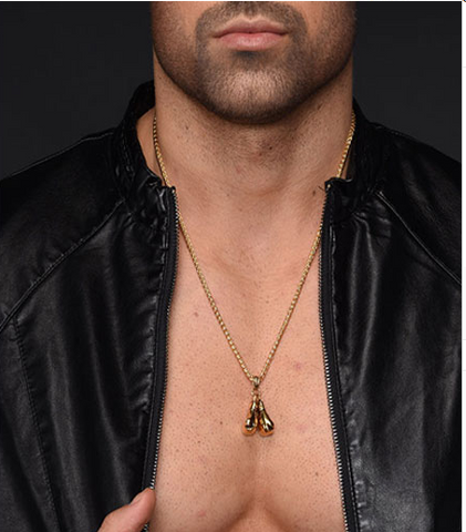 Man modelling boxing gloves necklace