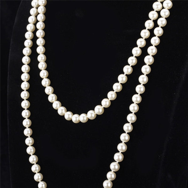 White Synthetic Pearl Maxi Length Multi-Layer Necklace Displayed on Mannequin