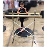 "rylee young from ""the crazy 8's oc"" dance team from world of dance using freestanding adjustable ballet barre with real wood barres ,standing on a dot2dance dance dot"