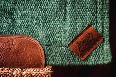 Spring Woven Saddle Pad- sage green close up of brown leather corner patch with Impact Gel logo