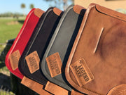 Four Legend Elite Saddle Pads in different colors with  brown leather finishing