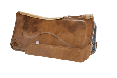 Legend Elite Saddle Pad with gray felt underside, brown eco-friendly leather cover, and brown leather finishing