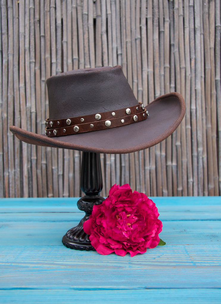 dark brown distressed double strap studded hat band on leather cowboy hat  with bamboo background d02f2cce1146