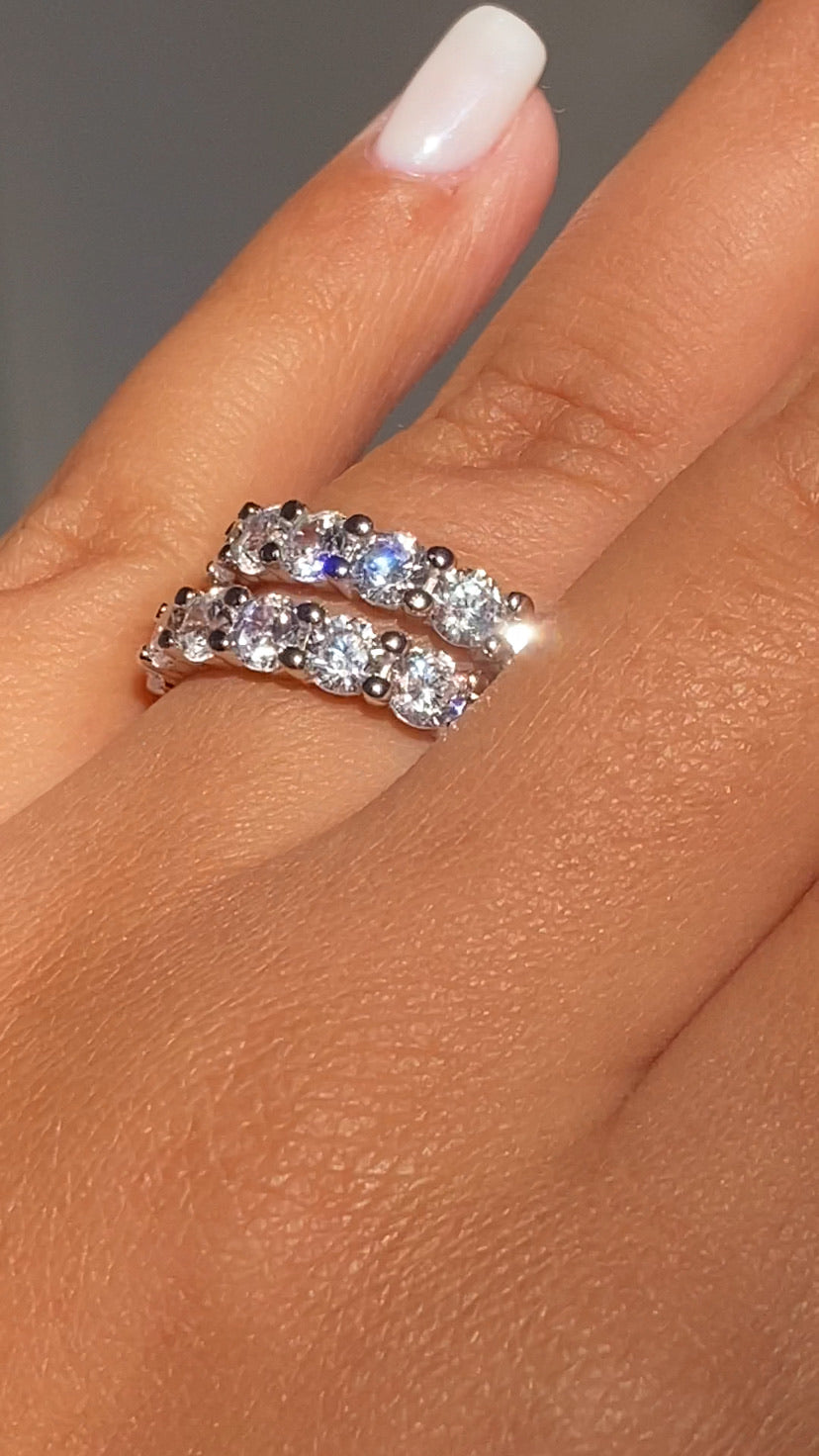 Ring Set (Comes with 2 separate Rings of the SAME size)  Round Cut  925 Sterling Silver  4mm High Grade AAAAA Cz (Simulated diamonds)  ( Please measure fingers before purchasing/ all sales are FINAL )  Rings sold as a set of 2.