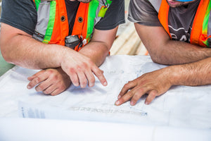 Two Construction Workers with Blueprint