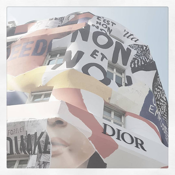 DIOR WRAPS THE FACADE OF THE AVENUE MONTAIGNE BOUTIQUE
