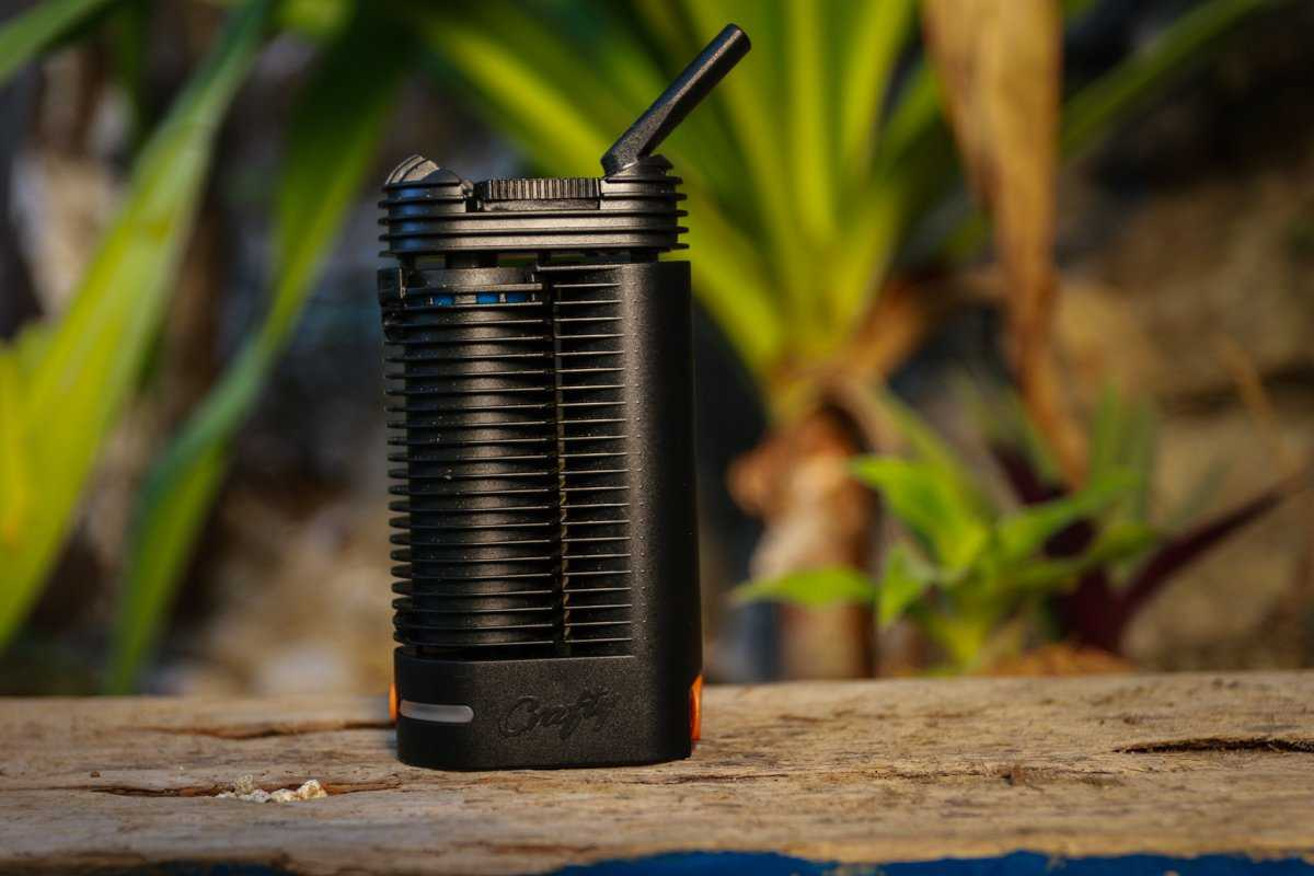 Crafty Vaporizer in front of plants