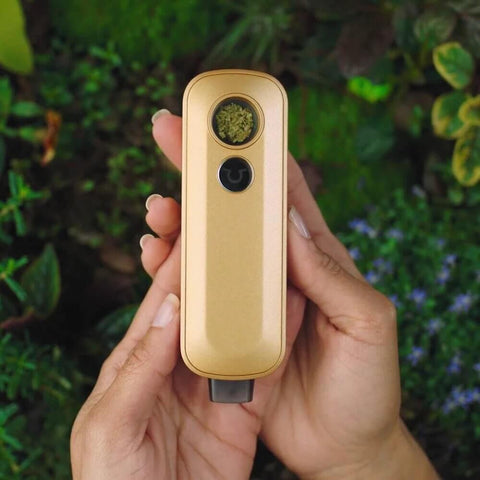 FireFly 2 plus Vaporizer gold in hand