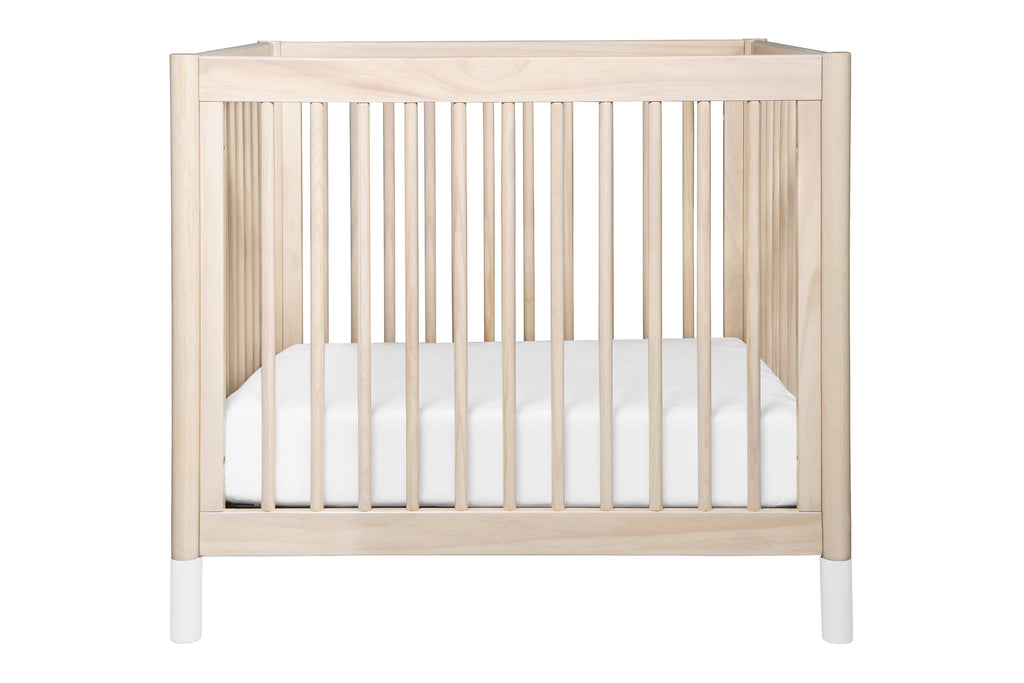 M12998NXW, Gelato 2-in-1 Mini Crib in Washed Natural with White Feet at front