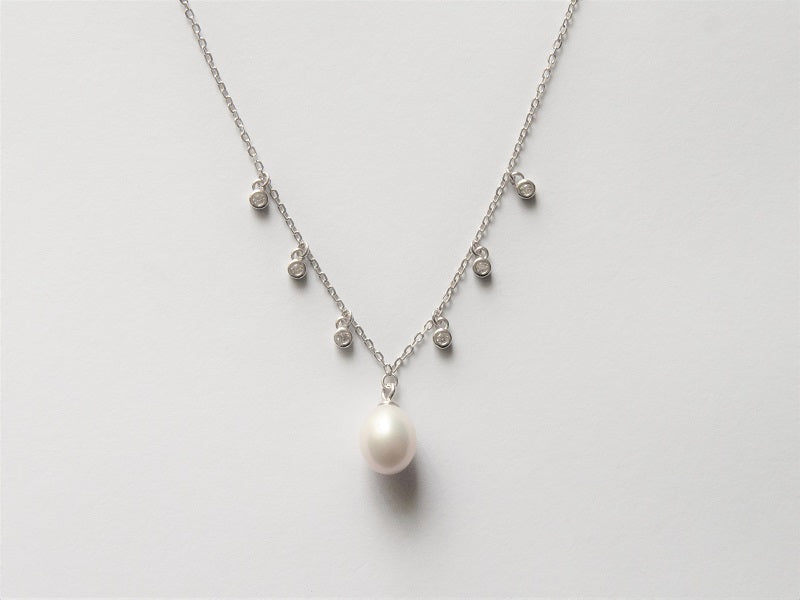 Silver & pearl pendant with CZ accents