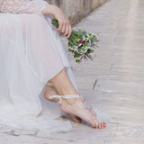 Barefoot destination bride wearing barefoot sandals foot jewelry