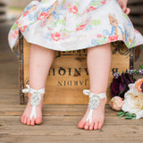 Little Girl wearing Crystal barefoot sandals