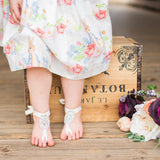 Legs of a Little Girl wearing Crystal barefoot sandals foot jewelry