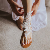 Lace barefoot sandals paired with regular sandals