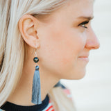Jeans blue long dangle tassel earrings with stone bead worn by blond girl