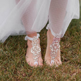 Boho barefoot bride walking in the grass