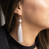 Close up for long dangle silver gray tassel earrings