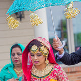 Hindu bride under the blue umbreall