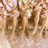 Beach wedding bridesmaids in flowery robes, wearing flower barefoot sandals