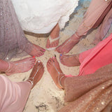 Beach wedding bridesmaids showing feet with barefoot sandals