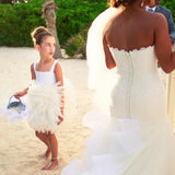 flower girl wearing Swarovski barefoot sandals and studs