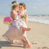 Beach wedding bridesmaid and flower girl