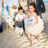 flower girl wearing warovski barefoot sandals and earrings