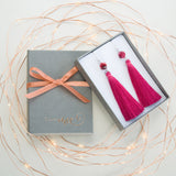 Gift Packing of the Blond Girl Wearing Navy Blue Long Tassel Earrings with Blue Sand Stone
