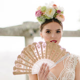 Spanish bride holding gold lace hand fan